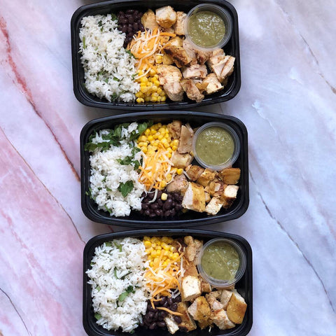 Homemade, chicken burrito bowls with salsa, corn, beans, cheese, meal prep