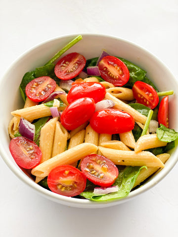 Vegetarian spinach pasta salad with olive oil