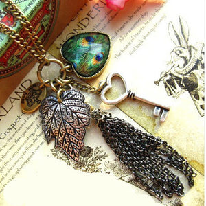 Korean Fashion Women Vintage Long Sweater Chain Love Heart Peacock Feather Leaves Key Tassel Retro