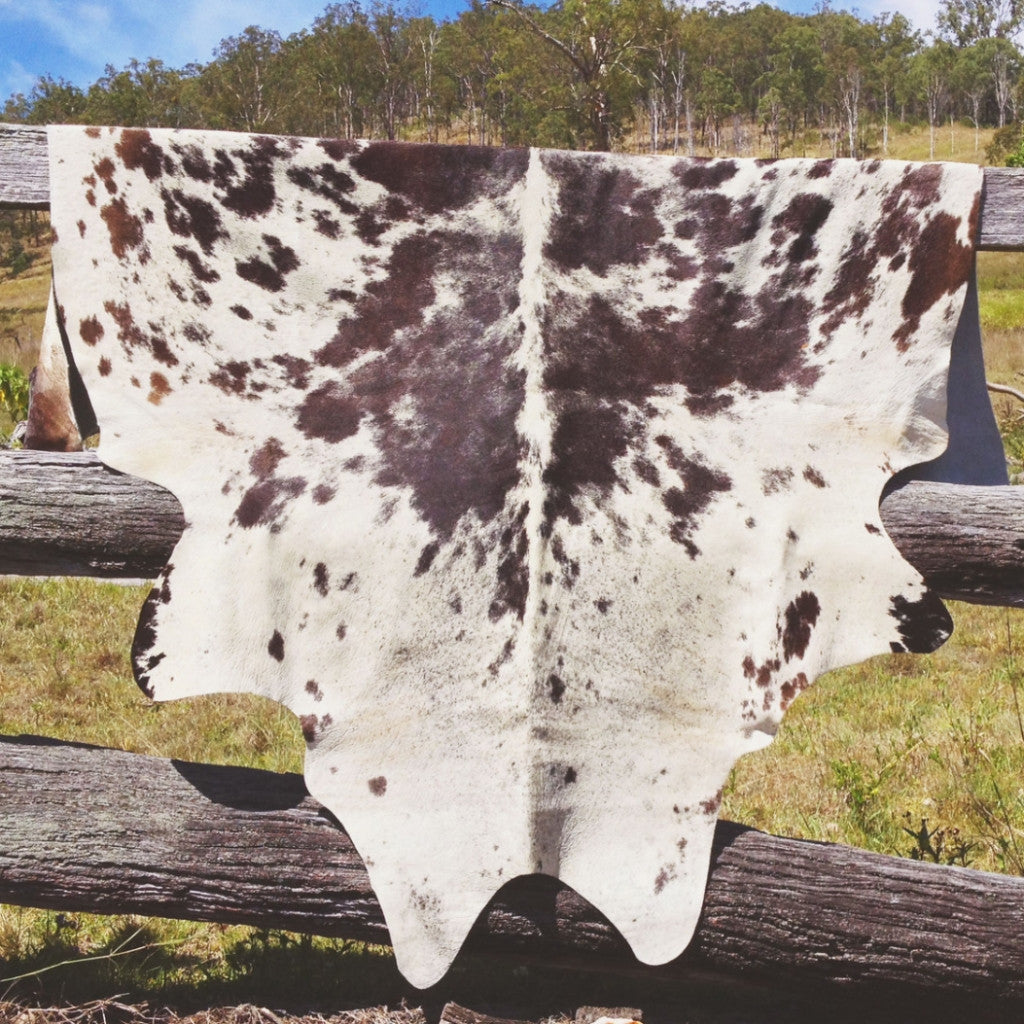 ONE OF A KIND NATURAL COWHIDE RUG
