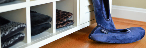 Velour Victoria Ballerina Slippers in Navy Blue with other ballerina slippers in cubbies