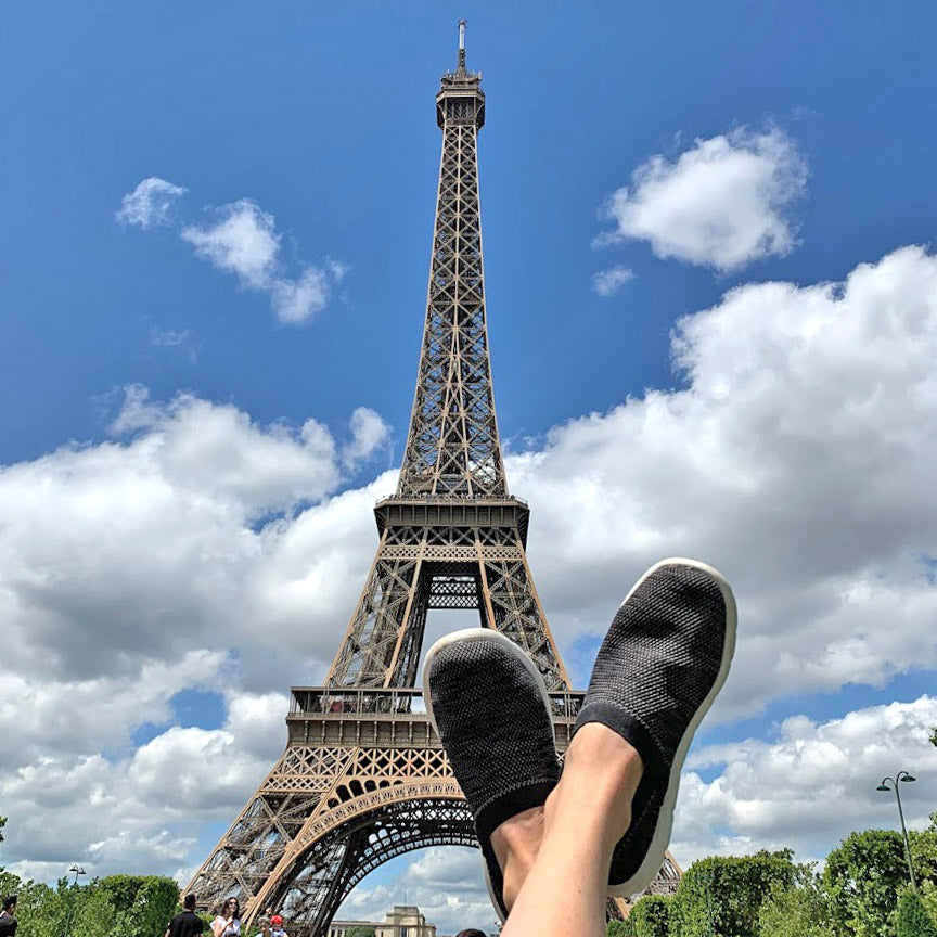 Women's Harmony Zenz in Black Marbled on model with her feet up and the Eiffel Tower in the background