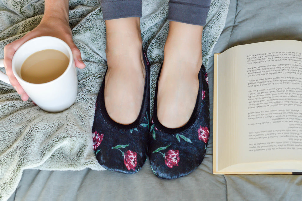 Velour Victoria Ballerina Slippers on model reading a book with coffee in her hand