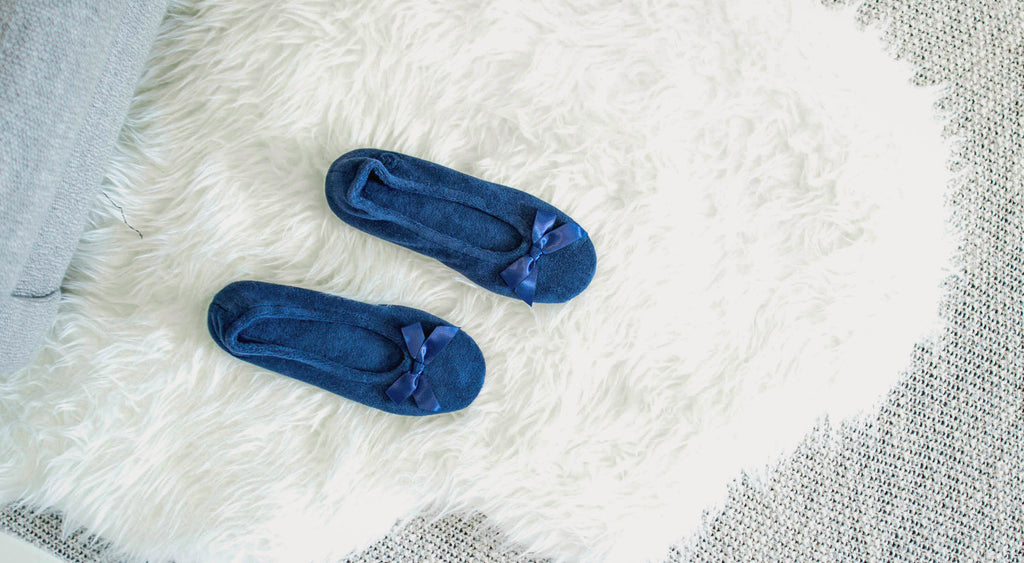 Classic Terry Ballerina Slippers on fuzzy fur rug