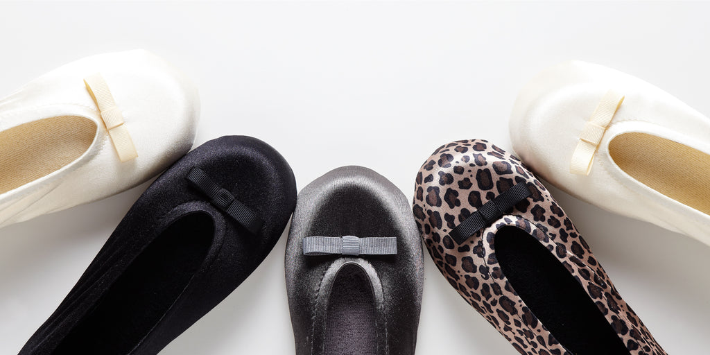 Signature Satin Ballerina Slippers in a variety of colors lined up