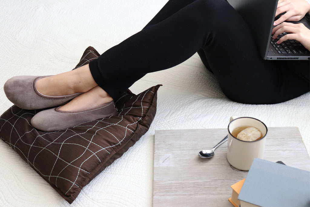 Women's Velour Victoria Ballerinas in Smokey Taupe on Model with feet up on pillow working on a laptop