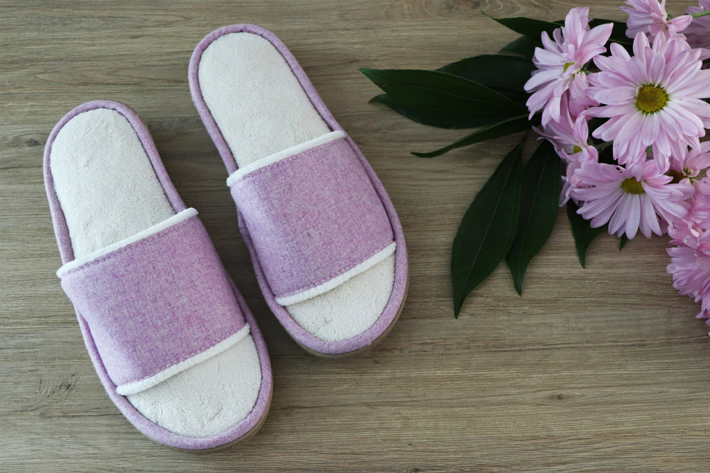 Summer Woolen Randi Slide Slippers flatlay sitting on wood with purple flowers