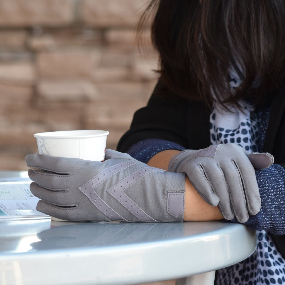Women's Chevron Shortie Gloves in Dusty Lavender on Model sitting in a cafe holding a to-go cup