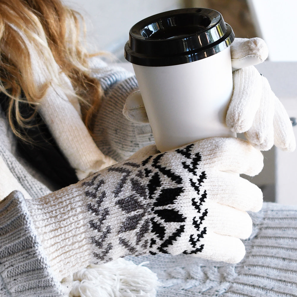 Women's Chenille Snowflake Gloves in ivory on figure, model holding coffee cup while bundled up outdoors