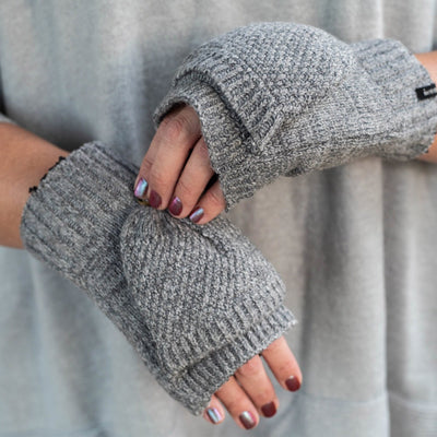 Women's Lined Recycled Fine Gauge Flip-Top Mitten in Charcoal Heather on figure. Model securing the flip top with button