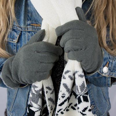 womens recycled stretch fleece glove close up on model holding scarf