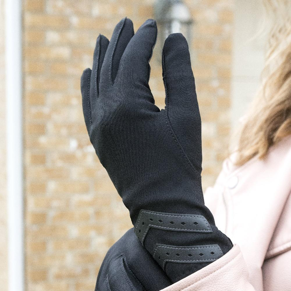 Women's Heritage Chevron Spandex Gloves in Black on figure standing in front of a brick building tugging at the wrist of the glove