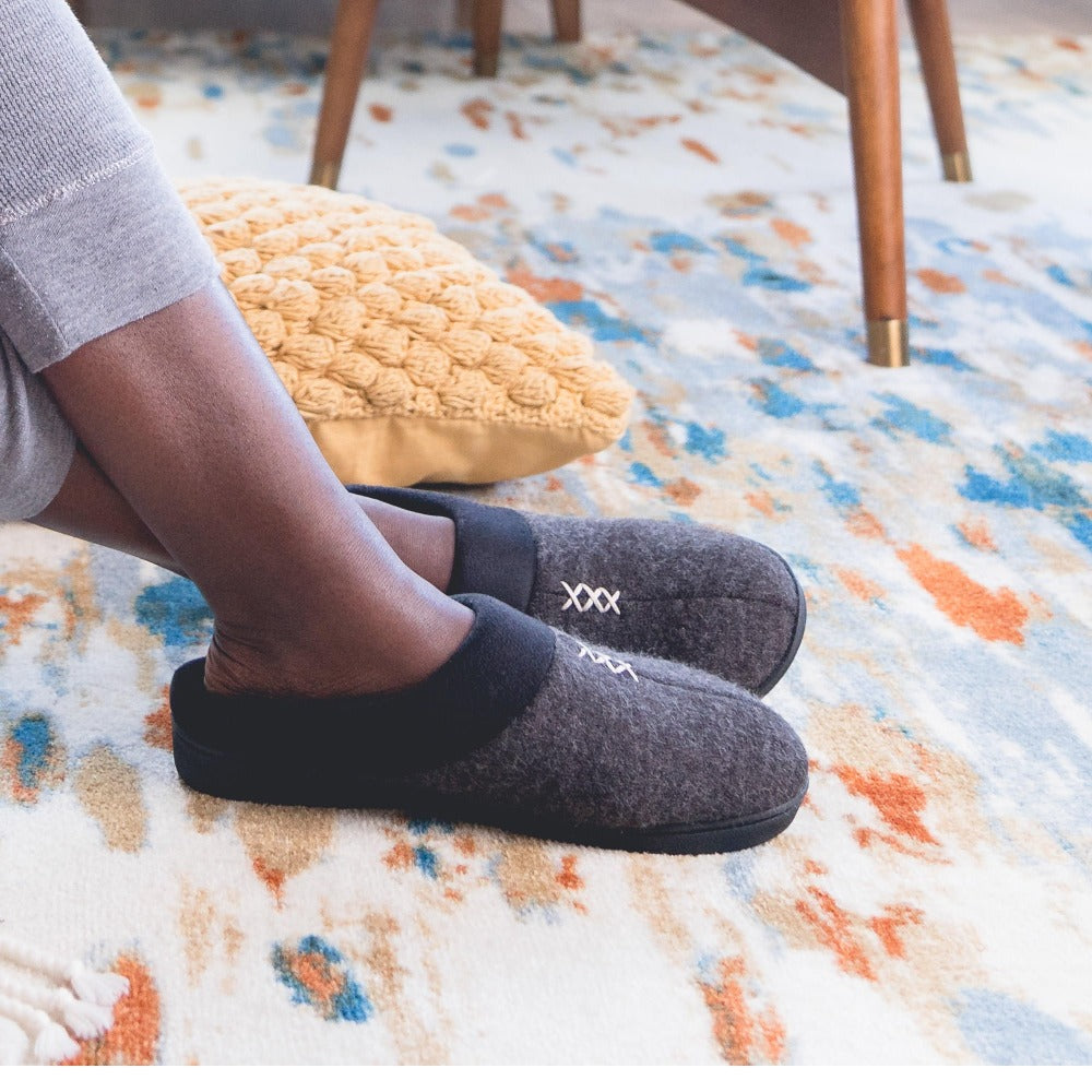 Women's Marisol Microsuede Knit Hoodback Slippers in Black on model on a printed rug