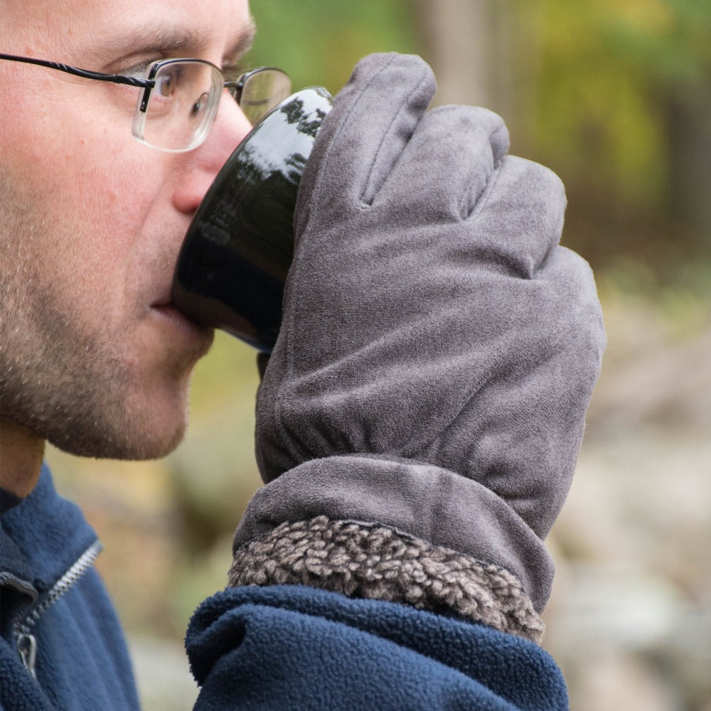 Men's Recycled Microsuede and Berber Glove pair in Lead Grey on figure. Male model wearing gloves and sipping from a coffee mug