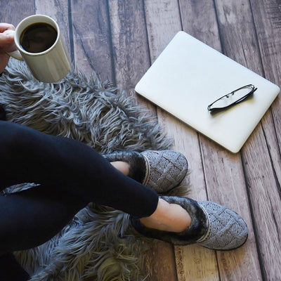 Women's Knit Tessa Hoodback Slippers in Stormy Grey On model with laptop and a cup of coffee