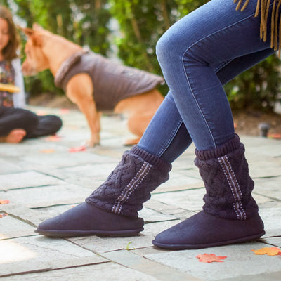 Women's Tessa Knit Tall Bootie Slippers in Navy on model outside with kid and a dog