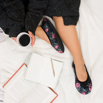 Women's Velour Victoria Ballerina Slippers in Floral on model sitting on a blanket with a book and notebook