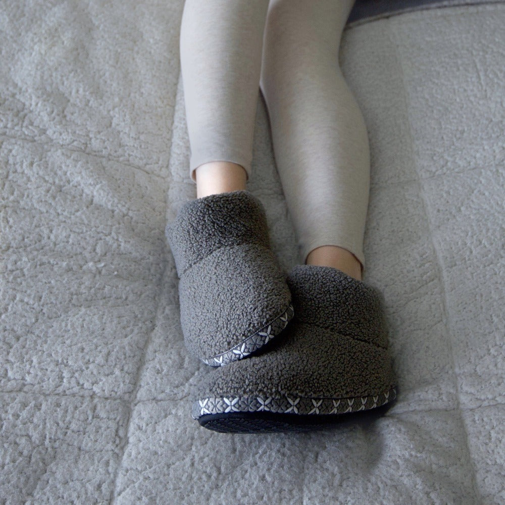 Women's Cozy Berber Nina Bootie Slippers in Mineral on Model Laying in Bed