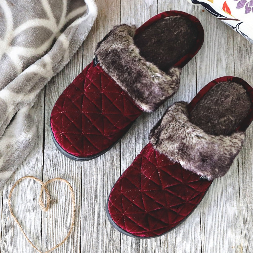 Women's Crushed Velour Stephanie Clog Slippers in Henna Red Laying flat on hardwood floor with cozy blanket