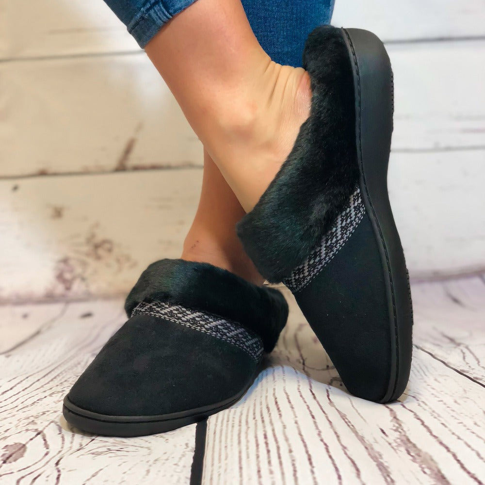 Women's Microsuede Basil Hoodback Slippers in Black on Model standing on hardwood floor