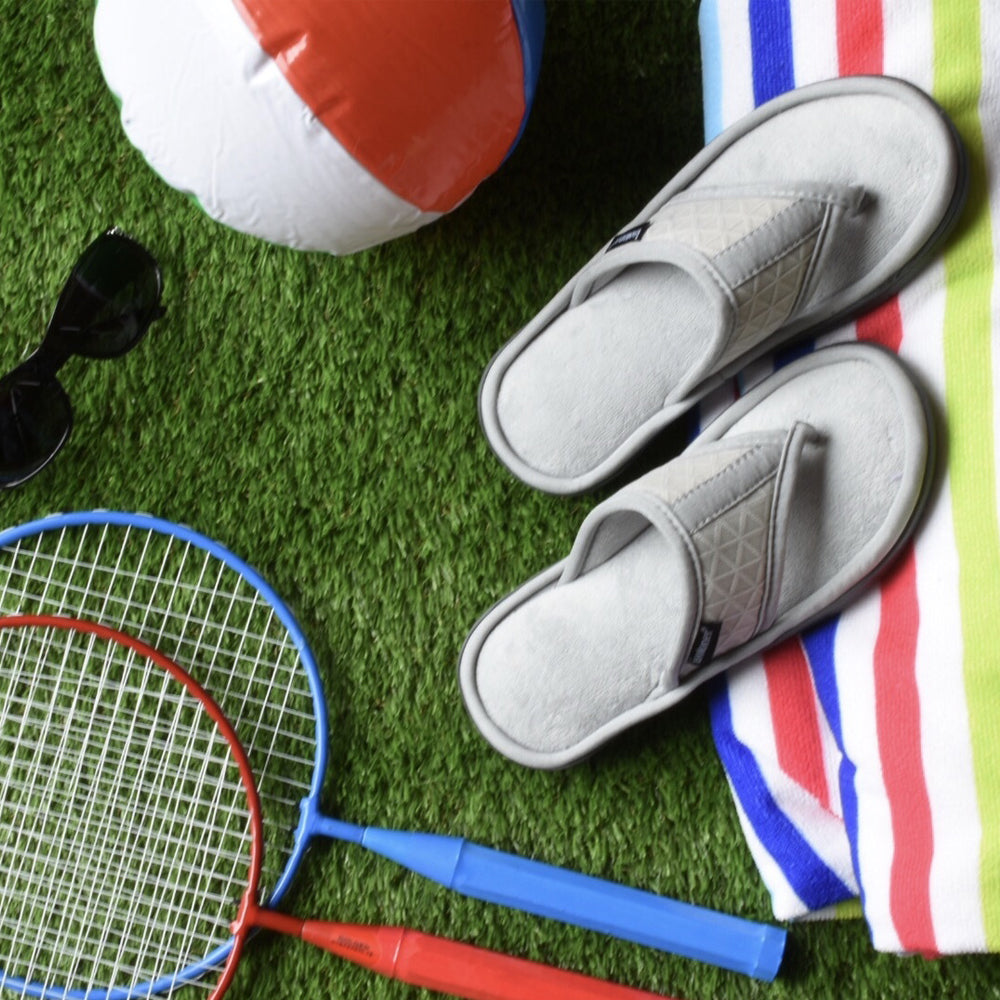Women's Mesh Mia Thong Slippers in Light Grey summertime flat lay with towel, beach ball, sunglasses and tennis rackets