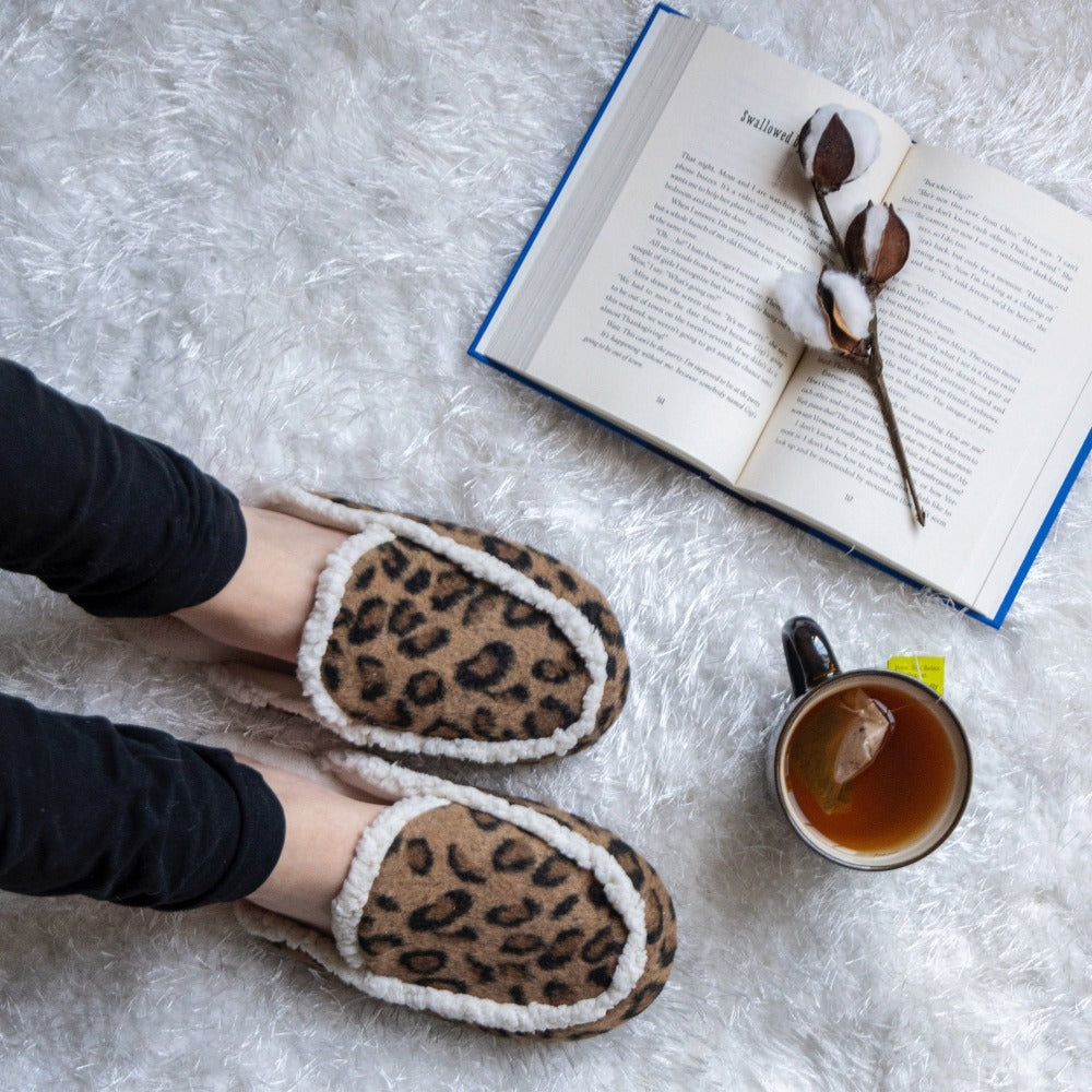 Women's Microsuede Alex Scuff Slippers in Buckskin (Cheetah Print) On Model Chilling with tea and a book