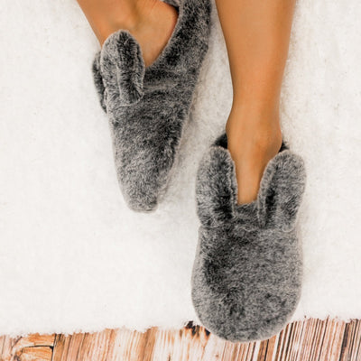 Women's Faux Fur Fey Novelty Hoodback Slippers in Black Bunny Ears In Model on Fur Rug