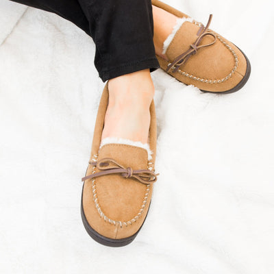 Women's Genuine Suede Moccasins in Buckskin on Model on Fur Blanket