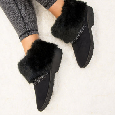 Women's Microsuede Addie Boot Slippers in Black on Model on Fur Rug