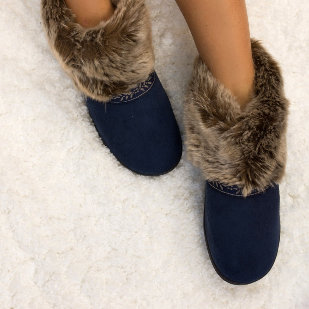 Women's Microsuede Addie Boot Slippers in Navy Blue on Model on Fur Rug