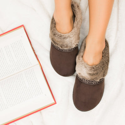 Women's Microsuede Addie Hoodback Slippers in Dark Chocolate on Model on plush Fur Rug with a book