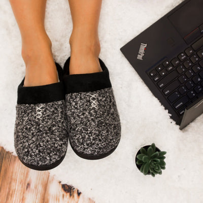 Women's Heathered Knit Jessie Hoodback Slippers in Dark Charcoal Heather on Model working on a laptop on a white fur rug