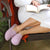 Women's Summer Woolen Randi Clog Slipper in Orchid on figure with model sitting in a comfy chair reading a book