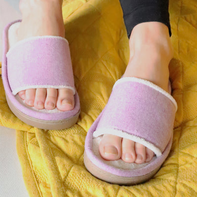 Women's Summer Woolen Randi Slide Slipper in Orchid (Pink) on figure laying on quilt