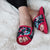Women's Petunia Floral Slide Slipper in Strawberry (Pink) on figure laying on fluffy blanket