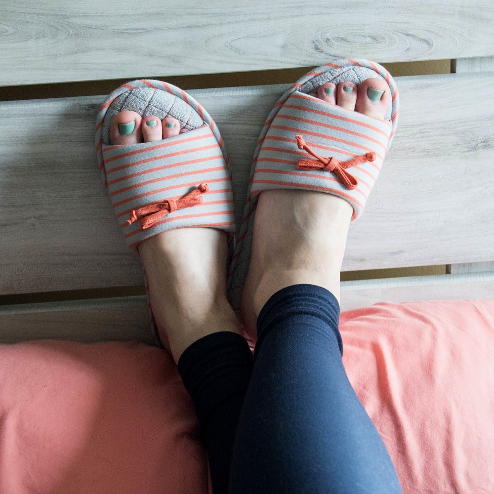 Women's Nani Stripe Slide Slippers in Stormy Grey on model with her feet propped up against a pillow and headboard