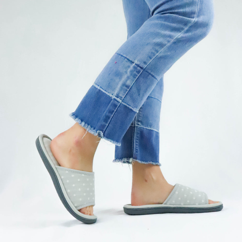 Women's Jersey Ada Slide Slipper in Stormy Grey on model wearing frayed jeans with her one leg popped behind her