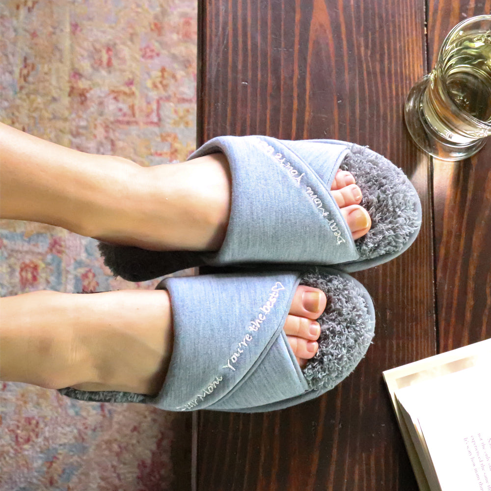 Women's Mother's Day Slide Slippers Ash Grey Top View quote reads Dear Mom, You're the best on model with feet up on coffee table with glass of wine and book