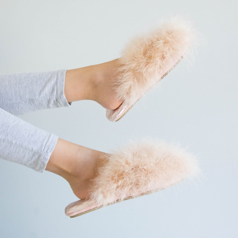 Women's Feather Sofia Scuff Slippers in Evening Sand Pink on figure model kicking her feet against a wall