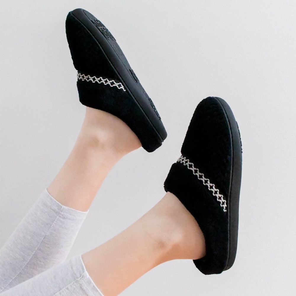 Women's Recycled Woven Popcorn Delilah Slipper in Black on figure with models feet in the air. Product in profile