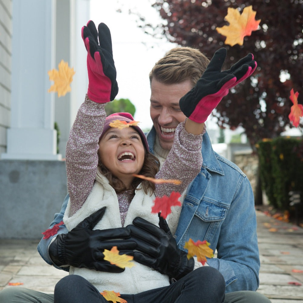 Girl wearing kid's fleece gloves in pink playing with her dad