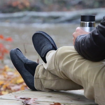 Men's Logan Herringbone Moccasin Slippers in Black on Model