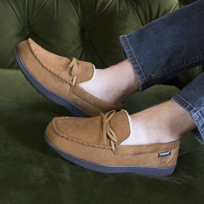 Men's Recycled Nigel Moccasin with Canvas Heel in Cognac brown on figure with the models feet up on a green couch