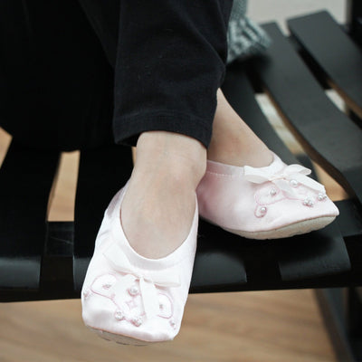 Girl's Satin Pearl Ballerina Slippers in Pale Pink on Model