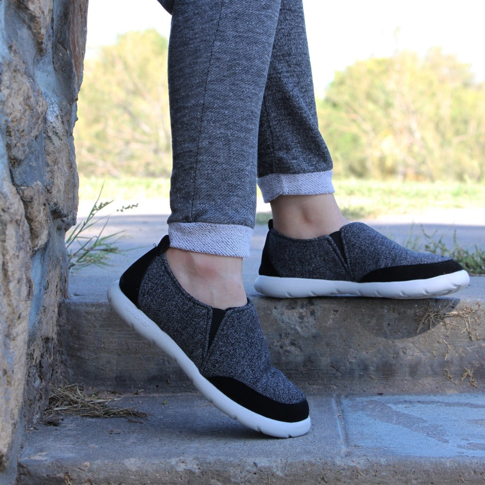 man wearing best selling mens activate slip on in black heather on steps