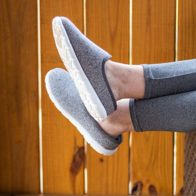 Model wearing Women's Energize Zenz SLip ons kicking her feet up