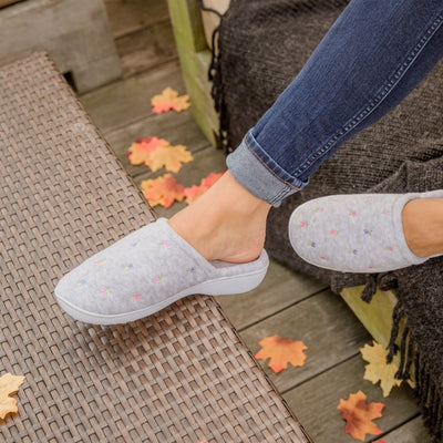 Woman wearing Embroidered Floral Terry Clog in grey color  sitting on Deck in fall