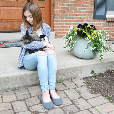 Women's Heathered Jersey Jillian Ballerina Slippers in Grey on Young Model outside with cat in arms