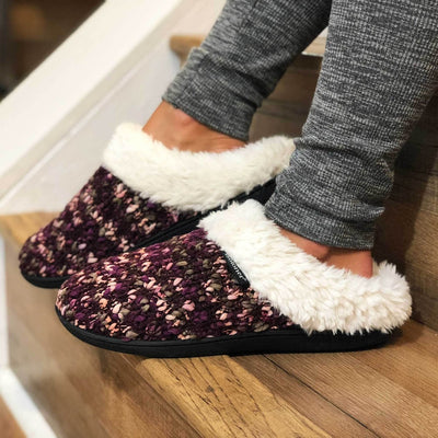 Women's Sweater Knit Amanda Hoodback Slippers in Henna (Maroon) on Model sitting on the stairs