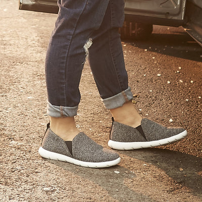 Woman wearing Black heather Zenz Tranquility slip ons getting into a car